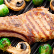 Stock Photo: Grilled pork chop with brussels sprouts