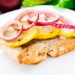 Salmon steak with lemon and onion — Stock Photo