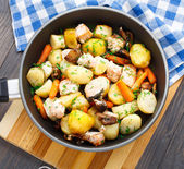 Baked salmon with potato, mushrooms and carrot — Stock Photo
