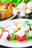 Vegetable salad with poached egg — Stock Photo