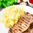 Stock Photo: Grilled pork with mashed potato