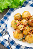 Potato with bacon and herbs — Stock Photo