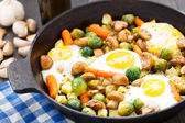 Baked eggs with vegetables and mushrooms — Stock Photo