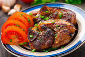 Pan fried pork with tomatoes — Stock Photo