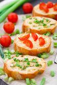 Bruschetta with cherry tomatoes and scallion — Zdjęcie stockowe