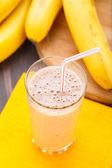 Glass of banana smoothie — Stock Photo
