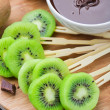 Fruits with chocolate on a stick — Stock Photo #47167385