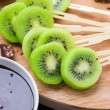 Fruits with chocolate on a stick — Stock Photo #47167393
