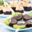 Fruits with chocolate on a stick — Stock Photo #47167395