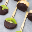Fruits with chocolate on a stick — Stock Photo #47167403