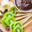 Fruits with chocolate on a stick — Stock Photo #47167421