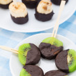 Fruits with chocolate on a stick — Stock Photo #47188563