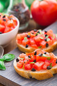 Italian bruschetta with tomatoes and basil — Stock Photo