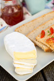 Sliced camembert cheese — Stock Photo