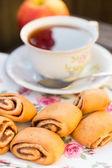 Cinnamon buns and a cup of tea — Stock Photo