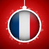 Wesołych świąt czerwoną piłkę z flaga francji — Wektor stockowy