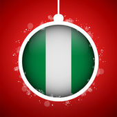 Merry Christmas Red Ball with Flag Nigeria — Stock Vector