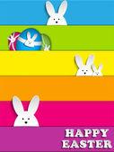 Glad påsk kanin bunny på rainbow bakgrund — Stockvektor