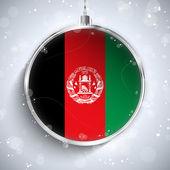 Bola de navidad feliz con bandera de afganistán — Vector de stock