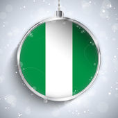 Merry Christmas Ball with Flag Nigeria — Stock Vector