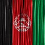 Afghanistan Flag Wave Fabric Texture — Stock Vector #34708729
