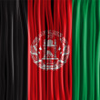 Afghanistan Flag Wave Fabric Texture — Stock Vector