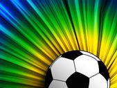 Futbol topu arka plan ile Brezilya bayrağı — Stok Vektör