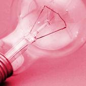 Background with lit lightbulb — Stock Photo