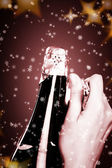 Opening champagne bottle — Stock Photo