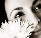 Girl with a white flower — Stock Photo