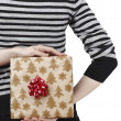 Young woman holding a present - Stock Photo
