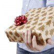 Young man holding a present — Stock Photo #23711407