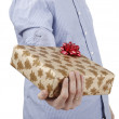 Young man holding a present — Stock Photo #26704427