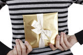 Young woman holding a present — Stock Photo