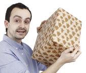 年轻男子持有一份礼物 — 图库照片