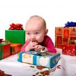 Baby Lying Amongst Christmas Gifts — Stock Photo #2062881