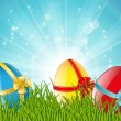Easter eggs in green grass — Imagen vectorial