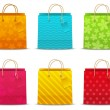 Set of color shopping bags — Stock Vector