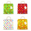 Set of color shopping bags with dots pattern — Imagen vectorial