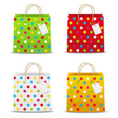 Set of color shopping bags with dots pattern — Stock Vector