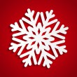 Paper Christmas snowflake on red — Stockvectorbeeld