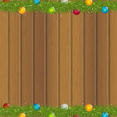 Christmas tree branches on wooden background — Stock Vector