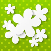Paper flowers on green background — Stock Vector