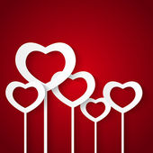 Paper hearts on red background — ストックベクタ