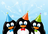 Cute penguins with party hats — Stock Vector