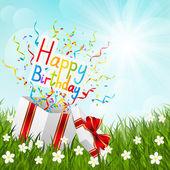 Birthday gift box on green grass — Stock Vector
