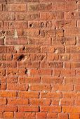 Grungy Brick Wall With Carvings — Stock Photo
