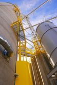 Grain Silos with Yellow Safety Areas — Stock Photo