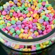 Large Glass Jar of Candy Hearts — Stock Photo