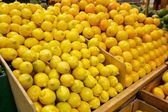 Wooden Bins Filled with Fresh Lemons and Oranges — Stock Photo